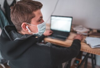 Student in mask studying