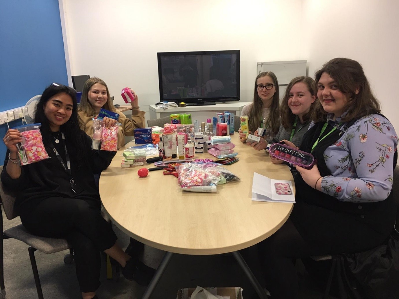 Women's society prepare goody bags for charity