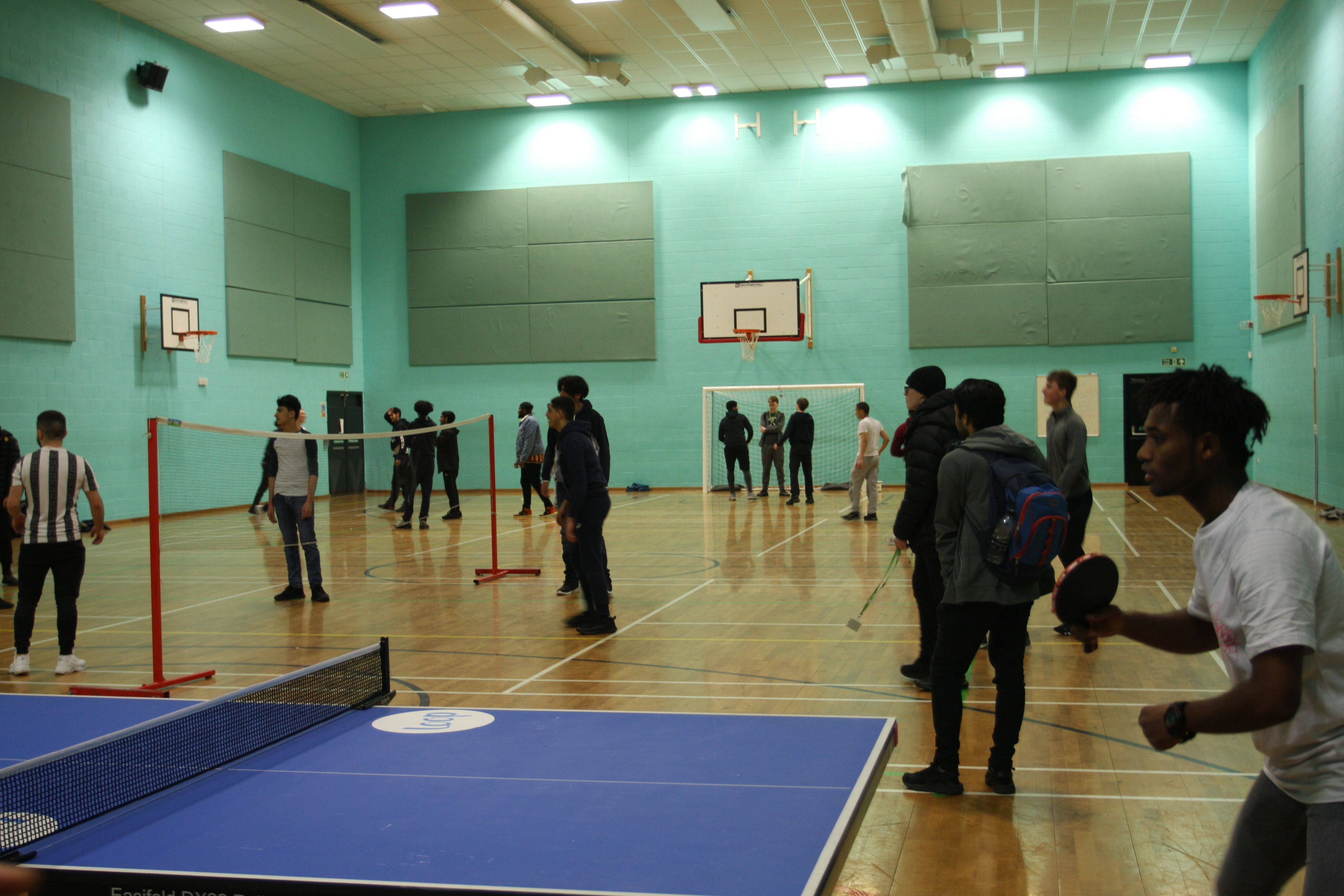 Students playing racket sports in the Sports Hall