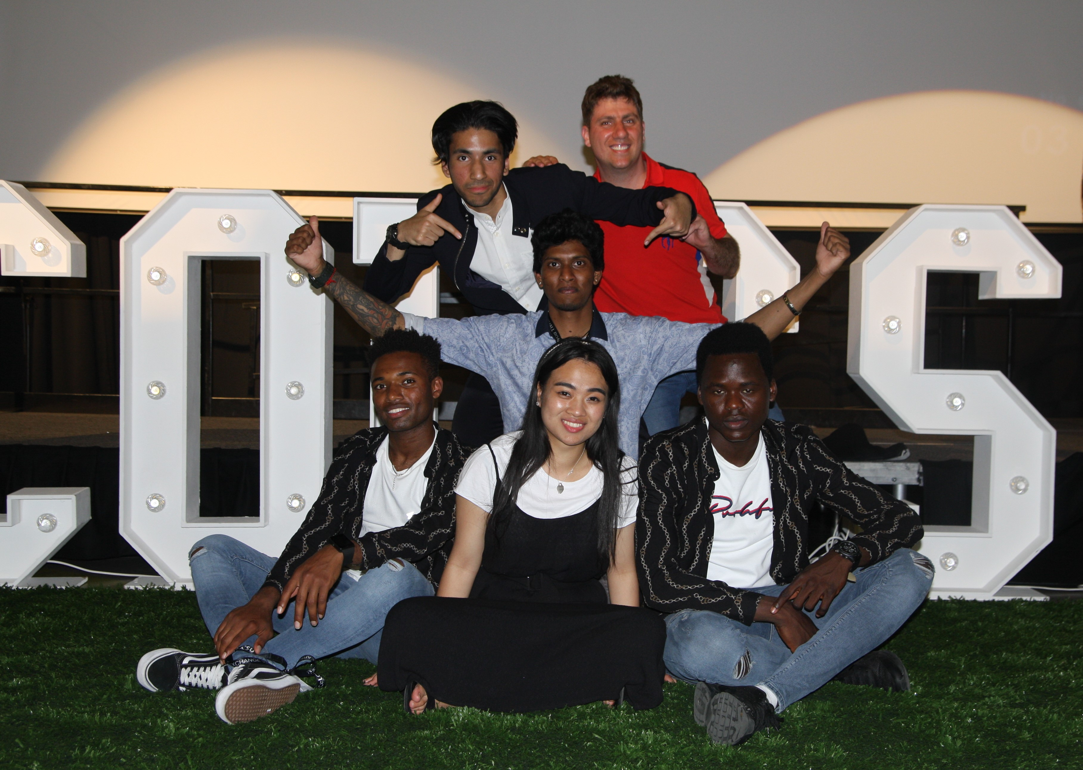 The Students' Union posing in front of CoLCSU logo