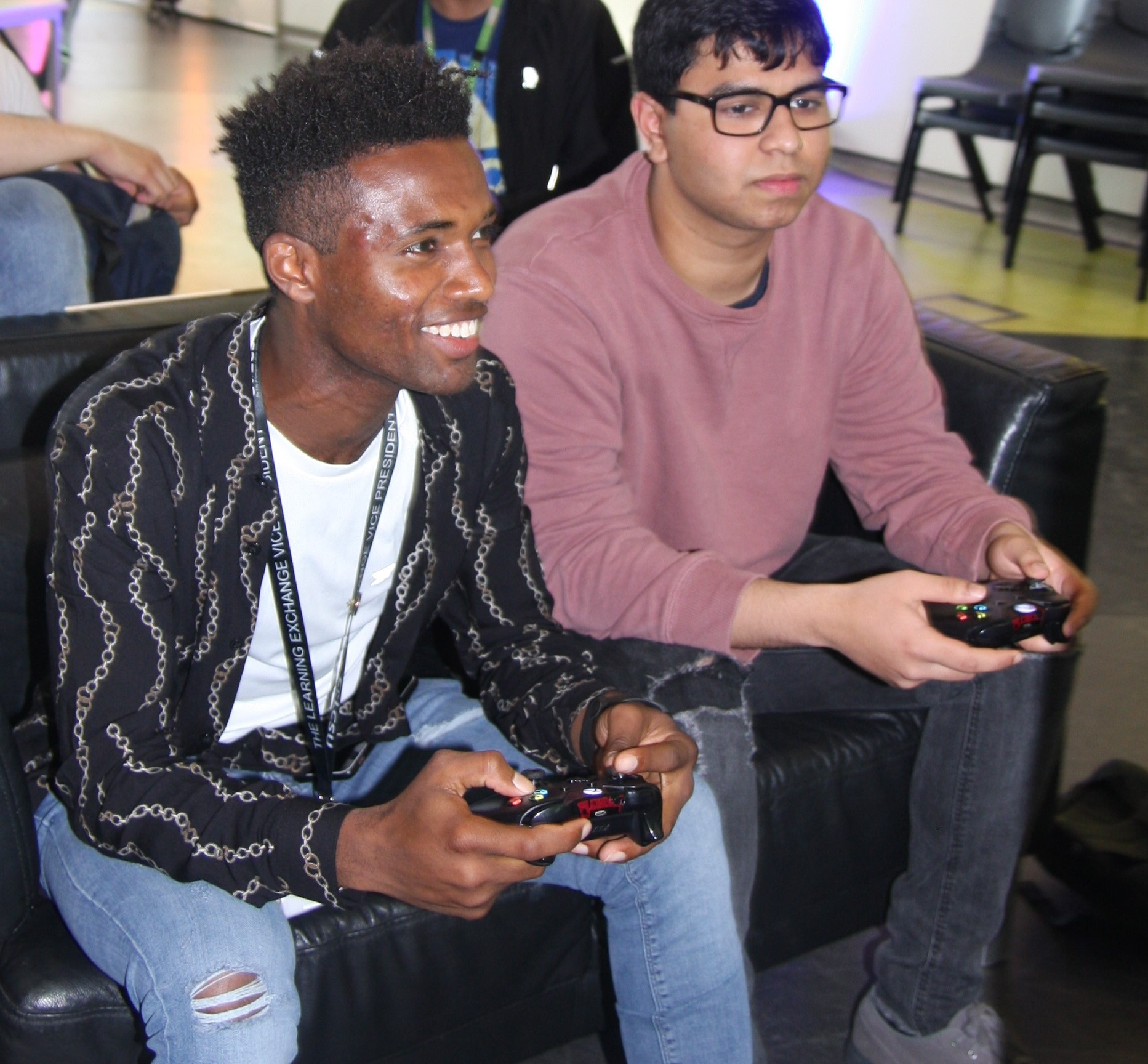 Students playing Xbox in gaming society