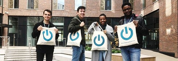 Four students holding SSO branded bags