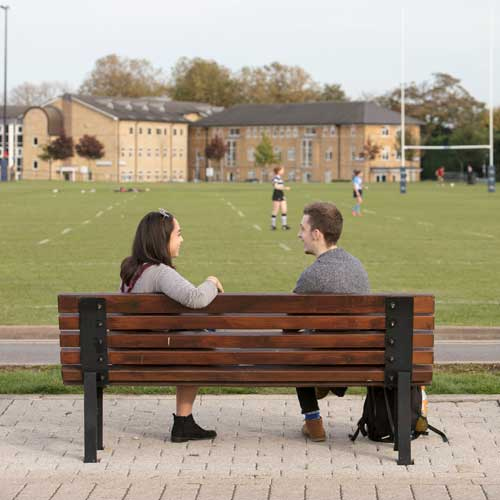 An image of some students talking in front of a St Mary's Halls block