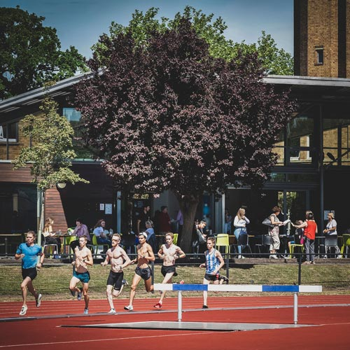 A picture of some students running on campus