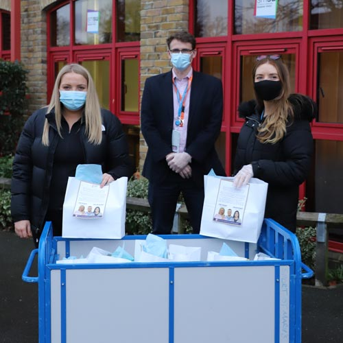 SMSU Staff members with isolation packs