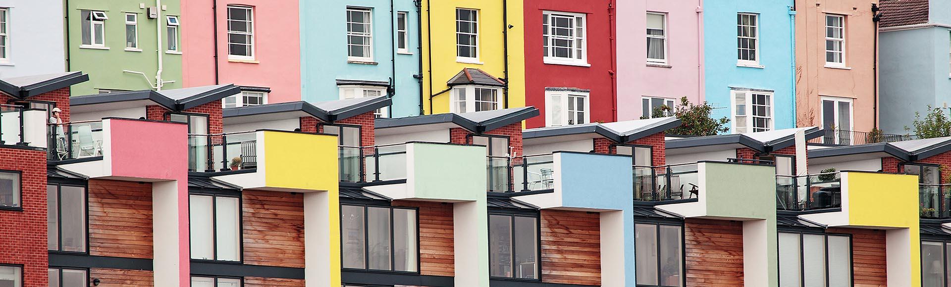 A row of rainbow-coloured houses