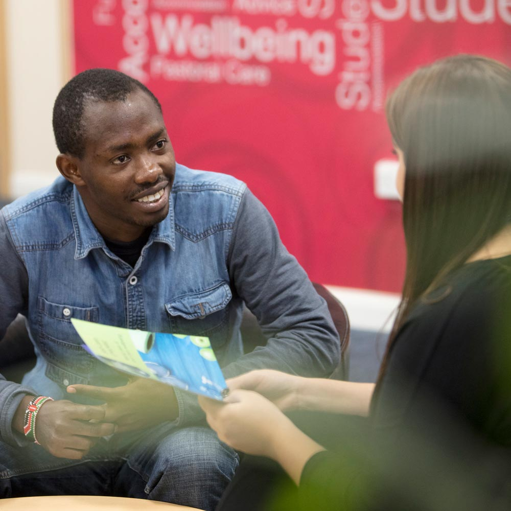 An image of a student talking to a Student Services Representative