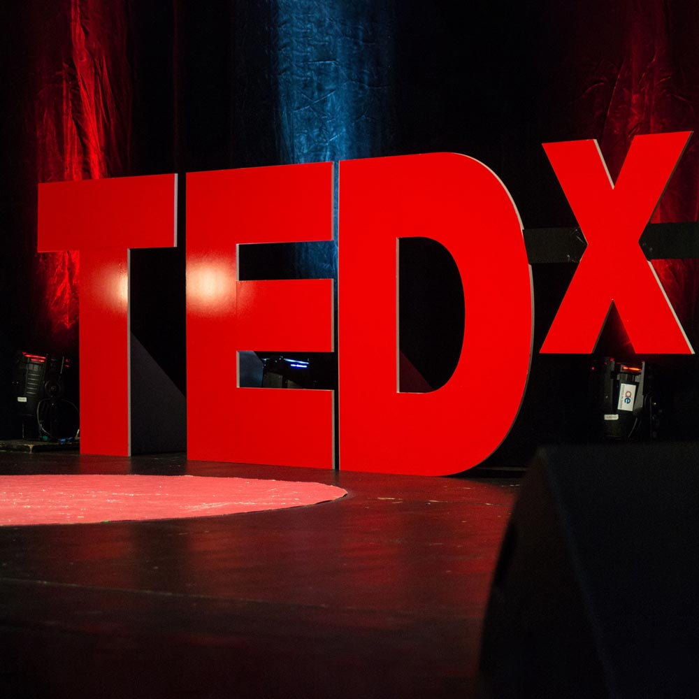 An image of the TED Talk background