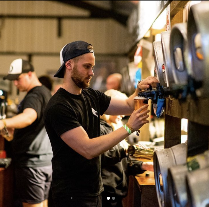 An image of a student working behind a bar