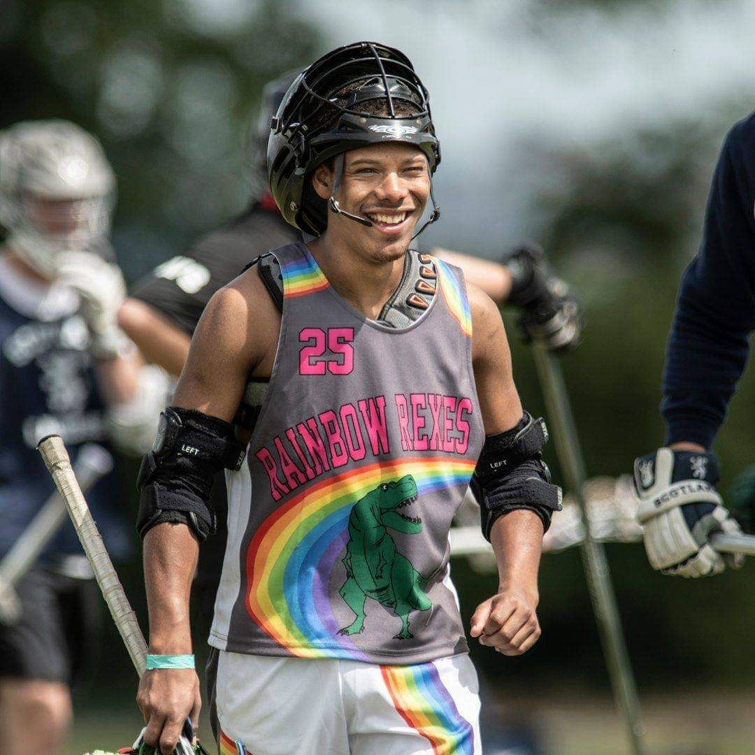 An image of a Rainbow Rexes player playing lacrosse