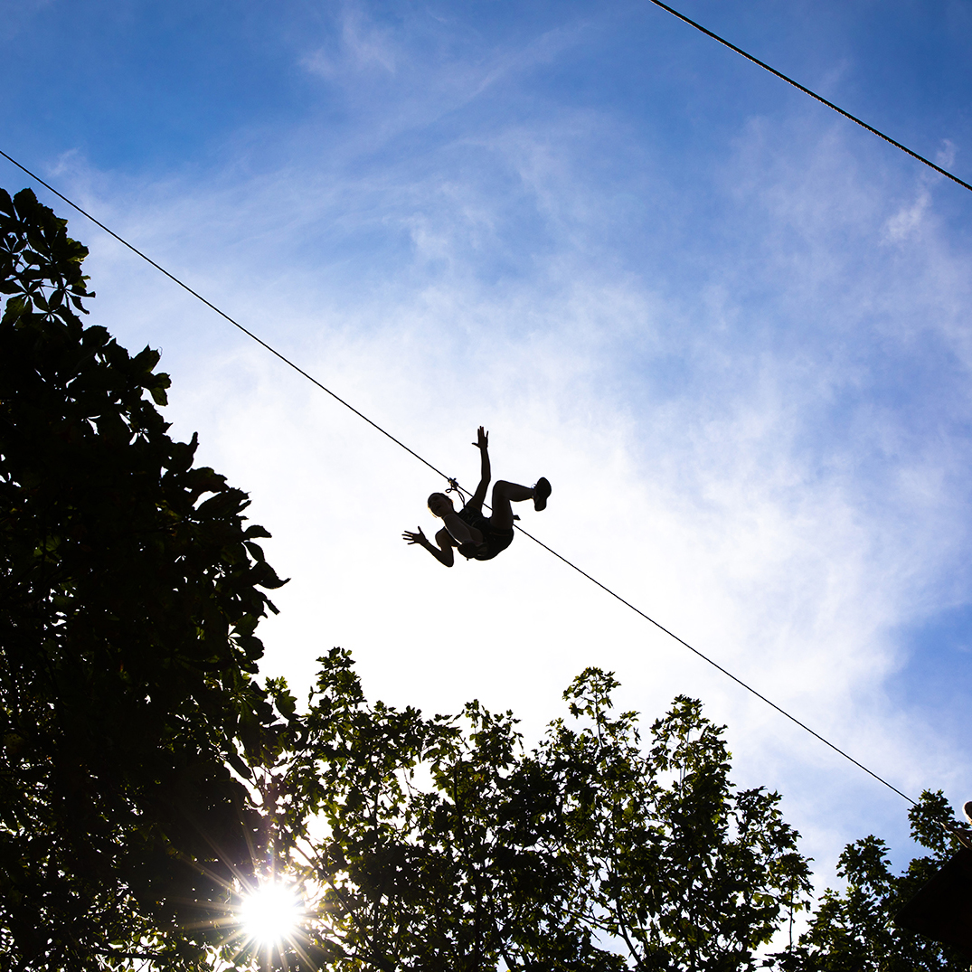 An image of a student on a zip wire