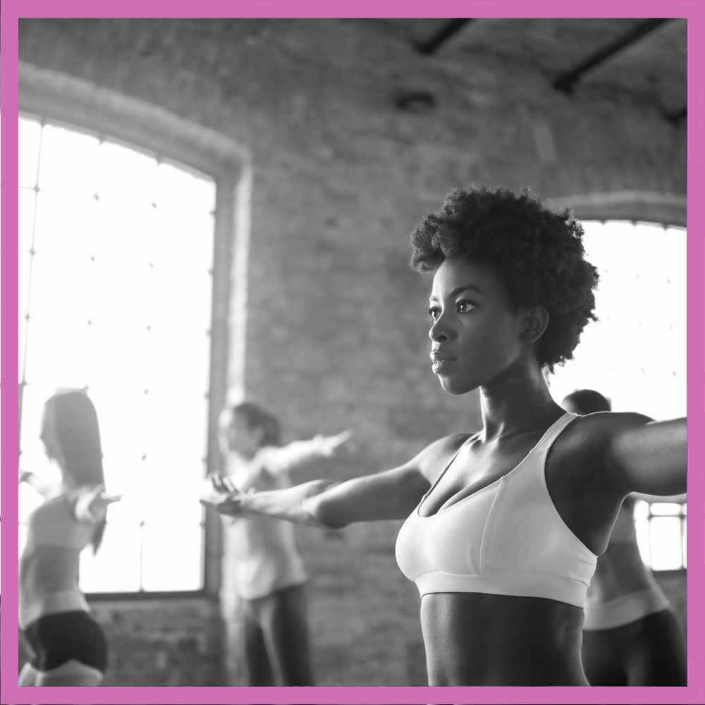 An image of a woman in a group exercise class