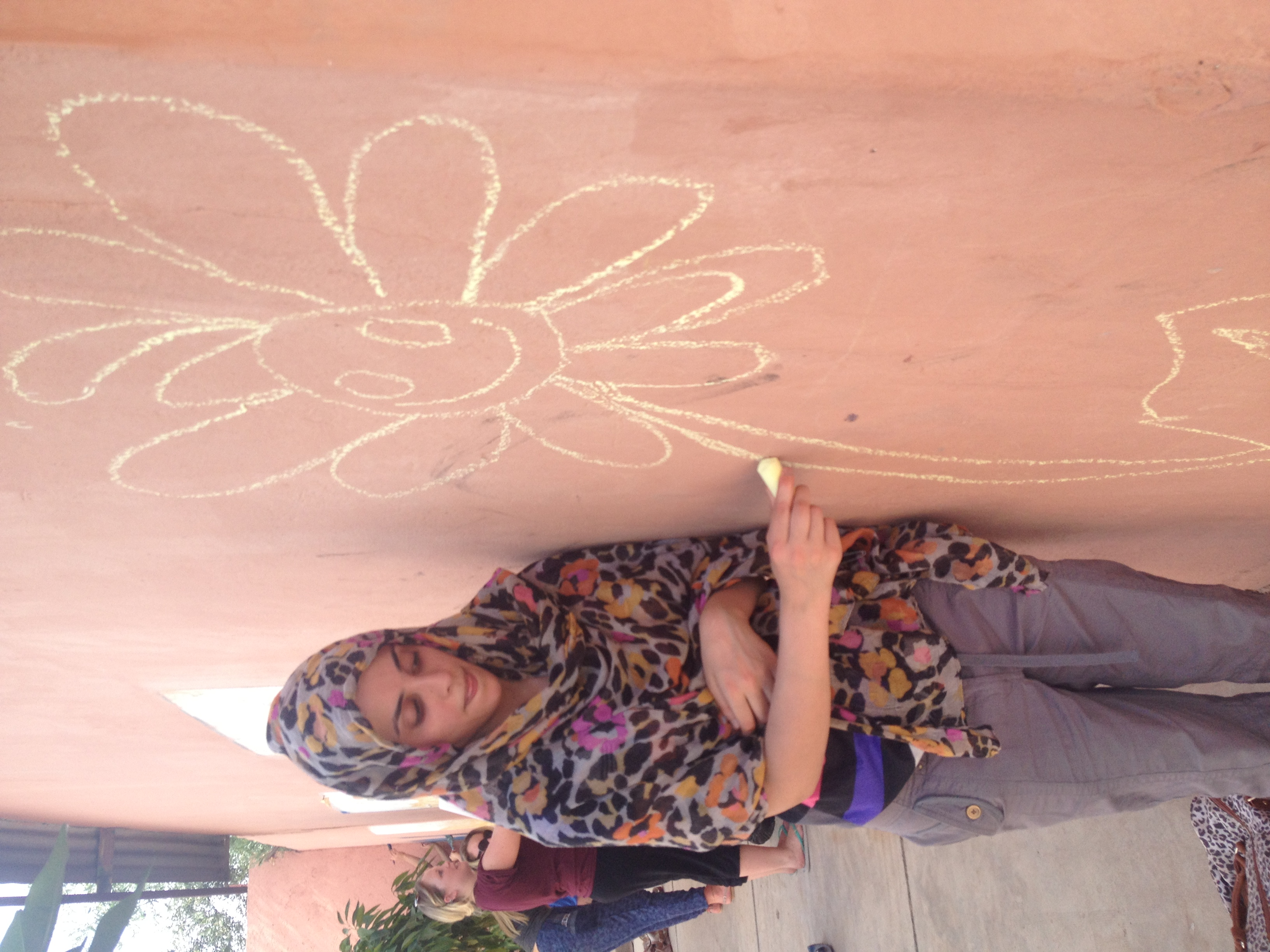 Female student drawing on a wall