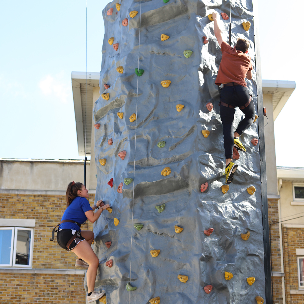 St Mary's students climbing a rock wall
