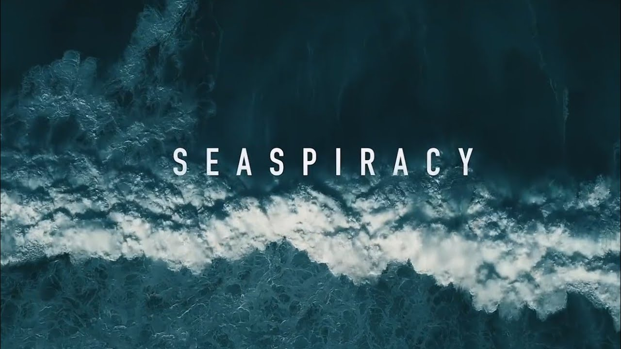 Documentary Poster. Seaspiracy Text on birds eye view of a deep ocean wave