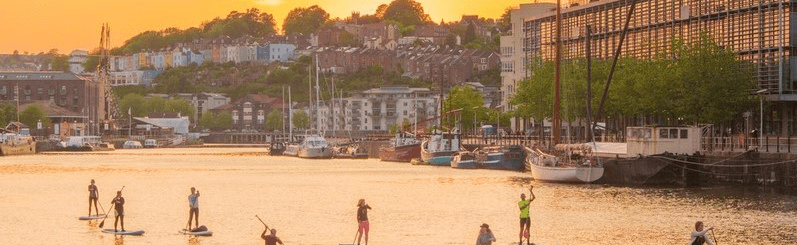 Paddleboarders in the Harbour at sunset