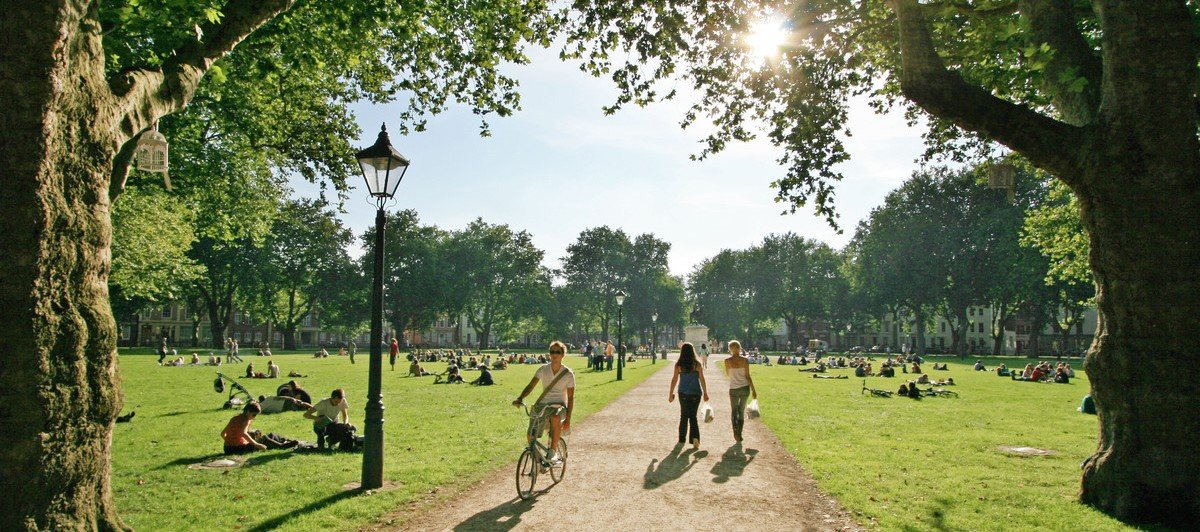 photo of a busy Bristol park on a sunny day