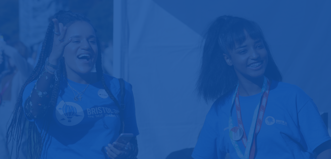 Photo of two Bristol SU staff smiling. The image has a blue overlay.